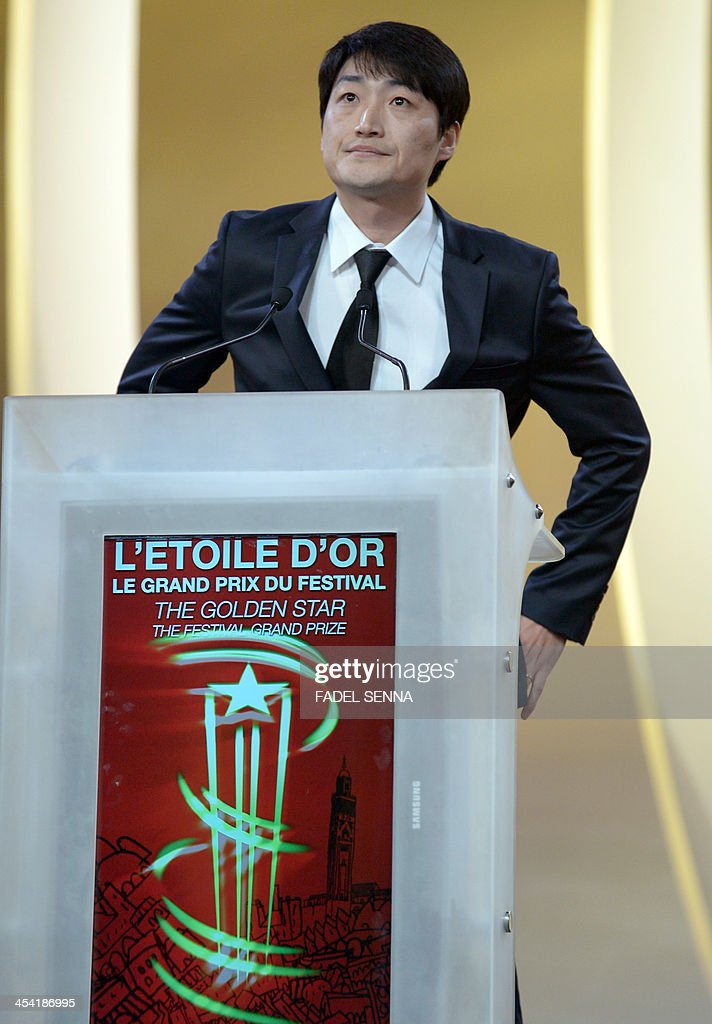 South Korean film director Lee Su-Jin delivers a speech after receiving the Golden Star award for his psychological drama film 'Han Gong-Ju' during the closing ceremony of the 13th Marrakech International Film Festival on December 7, 2013 in Marrakech.