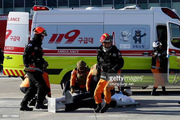 South Korean firefighters participate in an antiterror drill at the Olympic Staduim venue of the Opening and Closing ceremony on December 12 2017 in...