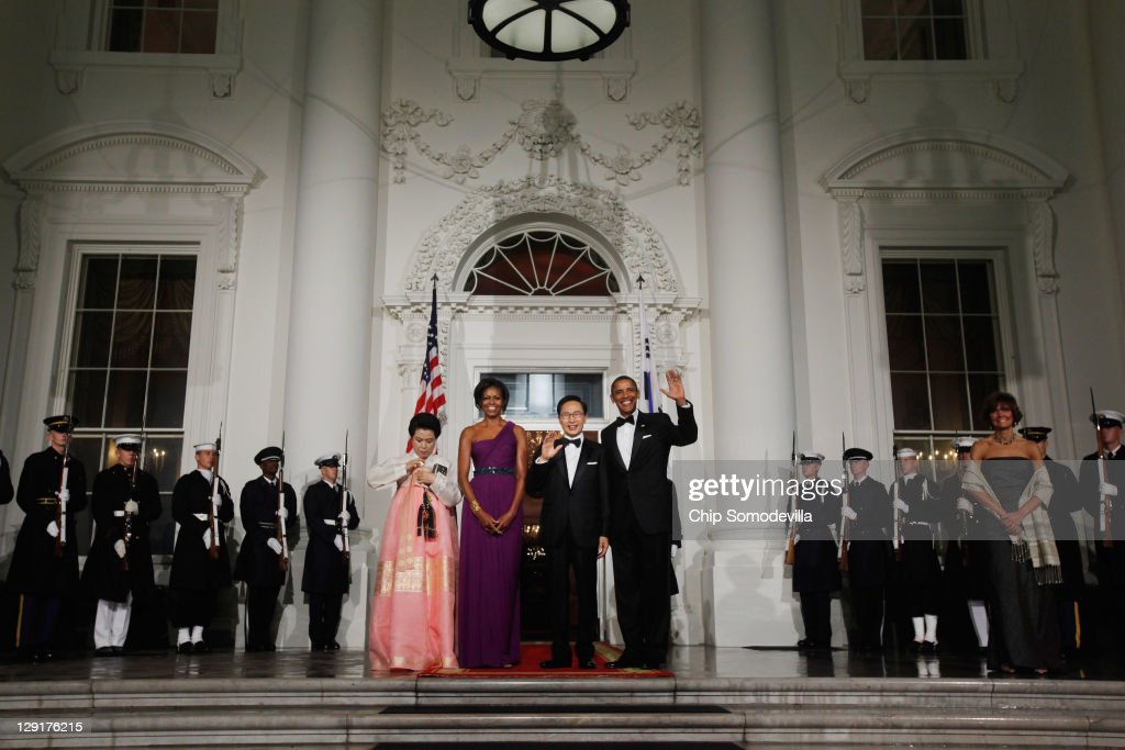South Korean first lady Kim Yoon-ok, U.S. first lady Michele Obama, South Korean President Lee Myung-bak and U.S. President <a gi-track='captionPersonalityLinkClicked' href=/galleries/search?phrase=Barack+Obama&family=editorial&specificpeople=203260 ng-click='$event.stopPropagation()'>Barack Obama</a> pose for photographs on the North Portico of the White House before attending a state dinner October 13, 2011 in Washington, DC. Earlier in the day, President Lee held a joint press conference with Obama and addressed a joint meeting of Congress.