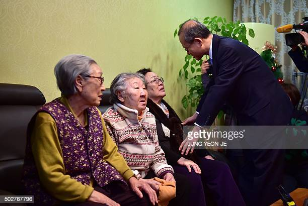 South Korean First Vice Foreign Minister Lim SungNam appeases former 'comfort woman' Lee YongSoo during his visit to a shelter for women who were...