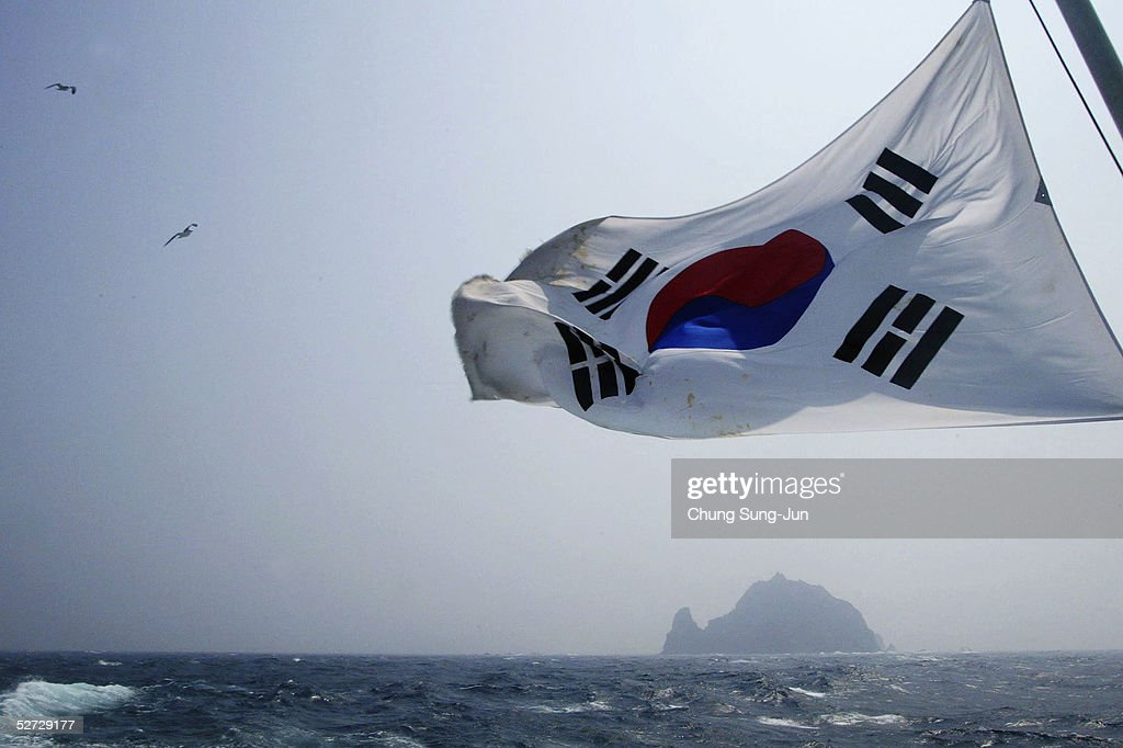 A South Korean flag flies from a South Korean coast guard ship as it sails close to the disputed Dokdo Islets, known by the Japanese as the Takeshima Islands, April 28, 2005 90 kilometres east of the South Korean Ullung Island. The volcanic islets have been a source of diplomatic tension betweem Seoul and Tokyo for years leading to violent anti-Japanese demonstrations breaking out in South Korea in recent weeks.