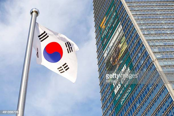 South Korean flag flies next to a large Presidents Cup banner displayed on the Northeast Asia Trade Tower the country's tallest building prior to the...