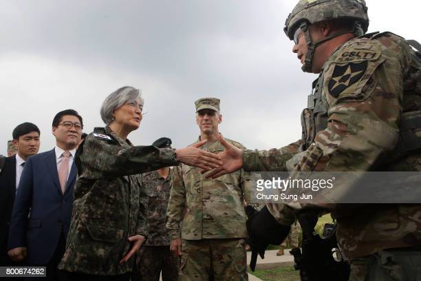 South Korean Foreign Minister Kang Kyungwha shakes hands with US soldier as Lieutenant General Thomas Vandal stands as she visits the headquarters of...