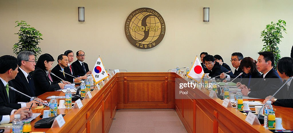 South Korean Foreign Minister Kim SungHwan talks with Japanese Foreign Minister Seiji Maehara during their meeting on January 15 2011 in Seoul South...