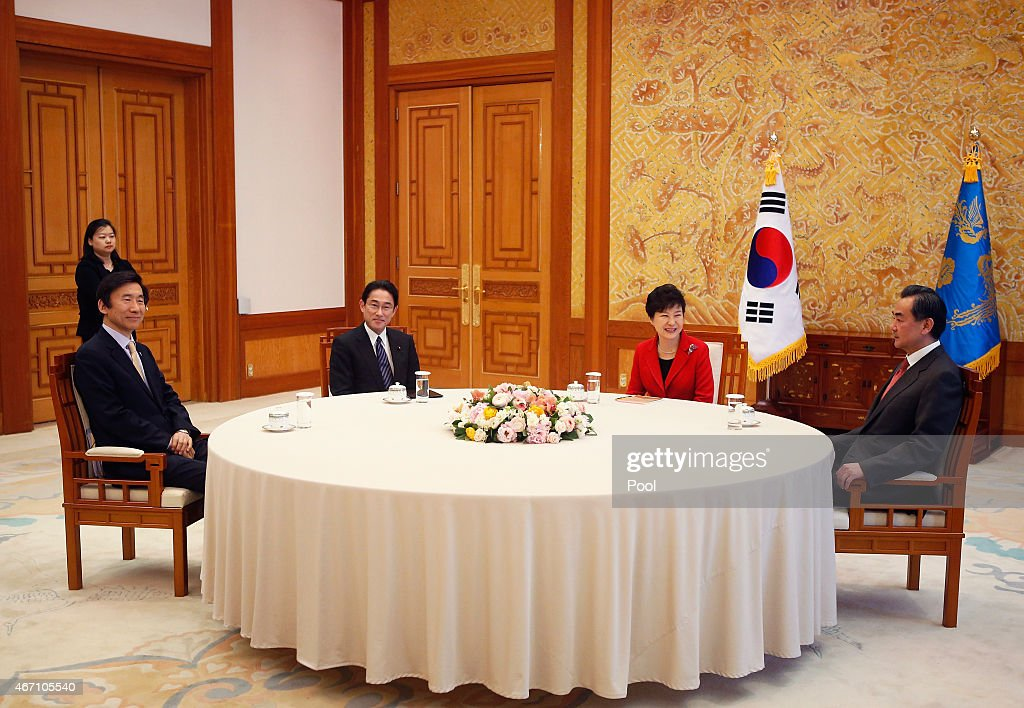 South Korean Foreign Minister <a gi-track='captionPersonalityLinkClicked' href=/galleries/search?phrase=Yun+Byung-Se&family=editorial&specificpeople=10574327 ng-click='$event.stopPropagation()'>Yun Byung-Se</a>, Japanese Foreign Minister <a gi-track='captionPersonalityLinkClicked' href=/galleries/search?phrase=Fumio+Kishida&family=editorial&specificpeople=10093794 ng-click='$event.stopPropagation()'>Fumio Kishida</a>, South Korea President Park Geun-Hye and Chinese Foreign Minister <a gi-track='captionPersonalityLinkClicked' href=/galleries/search?phrase=Wang+Yi+-+Homme+politique&family=editorial&specificpeople=13620429 ng-click='$event.stopPropagation()'>Wang Yi</a> attend during their meeting at the Presidential Blue House on March 21, 2015 in Seoul, South Korea. Foreign Minister Yun Byung-se of South Korea will chair the meeting with his Japanese and Chinese counterparts, <a gi-track='captionPersonalityLinkClicked' href=/galleries/search?phrase=Fumio+Kishida&family=editorial&specificpeople=10093794 ng-click='$event.stopPropagation()'>Fumio Kishida</a> and <a gi-track='captionPersonalityLinkClicked' href=/galleries/search?phrase=Wang+Yi+-+Homme+politique&family=editorial&specificpeople=13620429 ng-click='$event.stopPropagation()'>Wang Yi</a>, respectively. The trilateral Foreign Ministers' meeting happen for the first time in three years to concrete the path for restoring the trilateral cooperation mechanism.