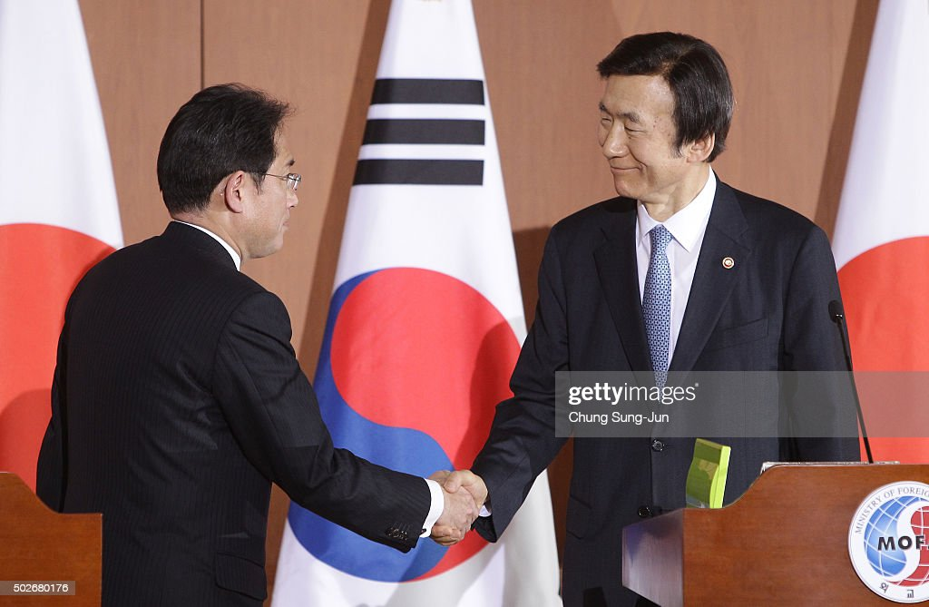South Korean Foreign Minister <a gi-track='captionPersonalityLinkClicked' href=/galleries/search?phrase=Yun+Byung-Se&family=editorial&specificpeople=10574327 ng-click='$event.stopPropagation()'>Yun Byung-Se</a> (R) shakes hands with Japanese Foreign Minister <a gi-track='captionPersonalityLinkClicked' href=/galleries/search?phrase=Fumio+Kishida&family=editorial&specificpeople=10093794 ng-click='$event.stopPropagation()'>Fumio Kishida</a> (L) after joint press conference at foreign ministry on December 28, 2015 in Seoul, South Korea. South Korean Foreign Minister Yun Byung Se and Japanese Foreign Minister <a gi-track='captionPersonalityLinkClicked' href=/galleries/search?phrase=Fumio+Kishida&family=editorial&specificpeople=10093794 ng-click='$event.stopPropagation()'>Fumio Kishida</a> met to discuss the issue of Korean 'comfort women' in Japanese military brothels before and during World War II.