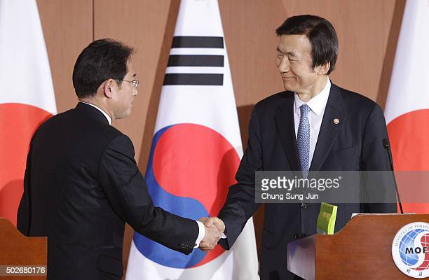 South Korean Foreign Minister Yun ByungSe shakes hands with Japanese Foreign Minister Fumio Kishida after joint press conference at foreign ministry...