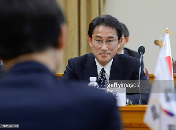 South Korean Foreign Minister Yun ByungSe talks with Japanese Foreign Minister Fumio Kishida before their meeting at foreign ministry on December 28...