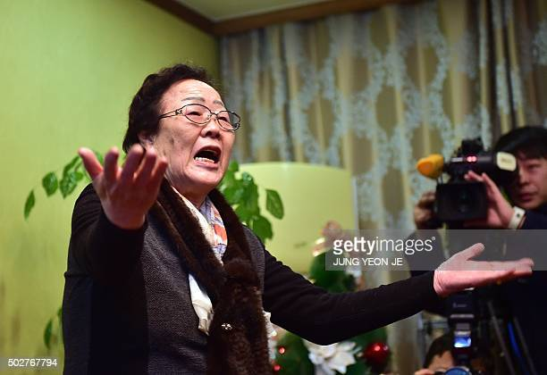 South Korean former 'comfort woman' Lee YongSoo makes a gesture of protest at South Korean First Vice Foreign Minister Lim SungNam during his visit...
