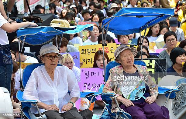 South Korean former 'comfort women' Kim BokDong and Gil WonOk who were forced to serve as sex slaves for Japanese troops during World War II attend a...