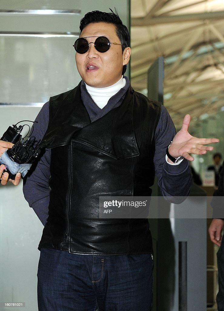 South Korean 'Gangnam Style' star Psy departs from Incheon International Airport for a flight to Los Angeles after taking a one-day-rest in Seoul on February 5, 2013. REPUBLIC OF KOREA OUT JAPAN OUT AFP PHOTO/STARNEWS