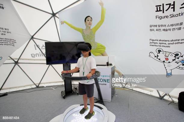 South Korean girl enjoy the PyeongChang Winter Olympics booth next to 'Bobsleigh In the City' event on August 19 2017 in Seoul South Korea The...