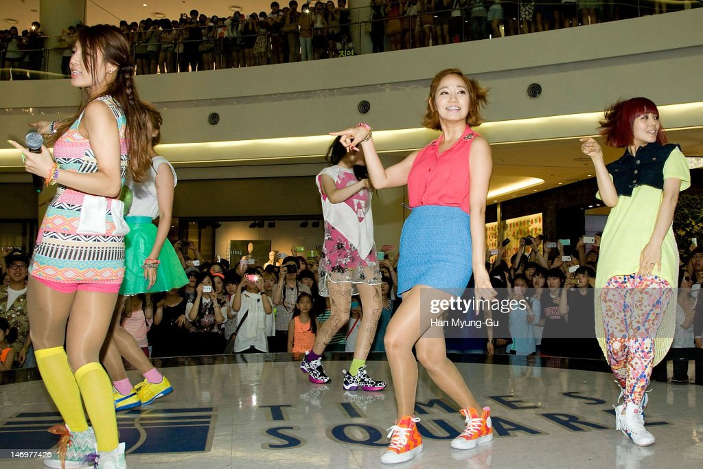 South Korean girl group Yenny (C) of <a gi-track='captionPersonalityLinkClicked' href=/galleries/search?phrase=Wonder+Girls&family=editorial&specificpeople=5637005 ng-click='$event.stopPropagation()'>Wonder Girls</a> attends during the 'Like This' Flashmob With <a gi-track='captionPersonalityLinkClicked' href=/galleries/search?phrase=Wonder+Girls&family=editorial&specificpeople=5637005 ng-click='$event.stopPropagation()'>Wonder Girls</a> at Times Square on June 24, 2012 in Seoul, South Korea.