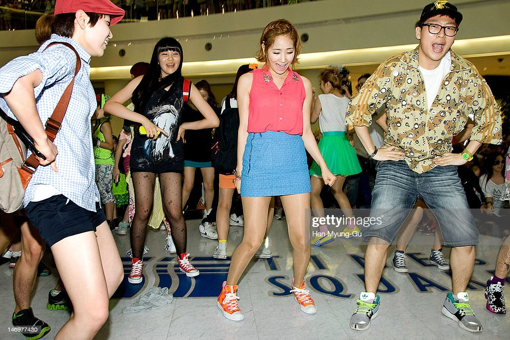 South Korean girl group Yenny of <a gi-track='captionPersonalityLinkClicked' href=/galleries/search?phrase=Wonder+Girls&family=editorial&specificpeople=5637005 ng-click='$event.stopPropagation()'>Wonder Girls</a> attends during with their fans the 'Like This' Flashmob With <a gi-track='captionPersonalityLinkClicked' href=/galleries/search?phrase=Wonder+Girls&family=editorial&specificpeople=5637005 ng-click='$event.stopPropagation()'>Wonder Girls</a> at Times Square on June 24, 2012 in Seoul, South Korea.
