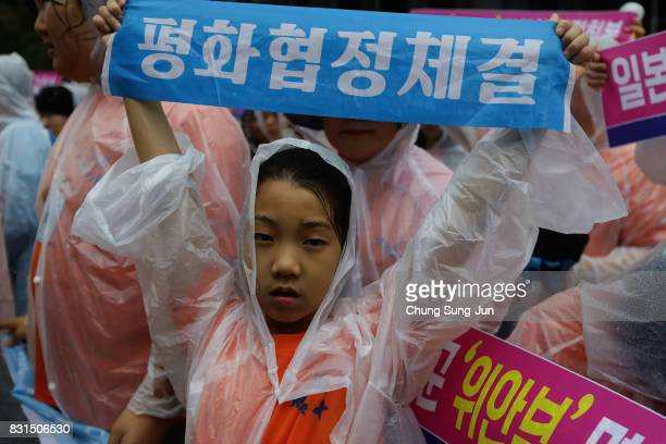 South Korean girl holds a placard during the 72nd Liberation Day rally in front of Japanese embassy on August 15 2017 in Seoul South Korea Korea was...