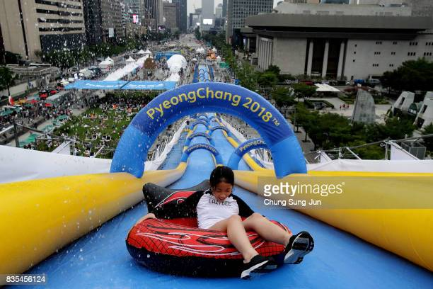 South Korean girl slides down on an inflatable ring during the 'Bobsleigh In the City' on August 19 2017 in Seoul South Korea The 22metrehigh...