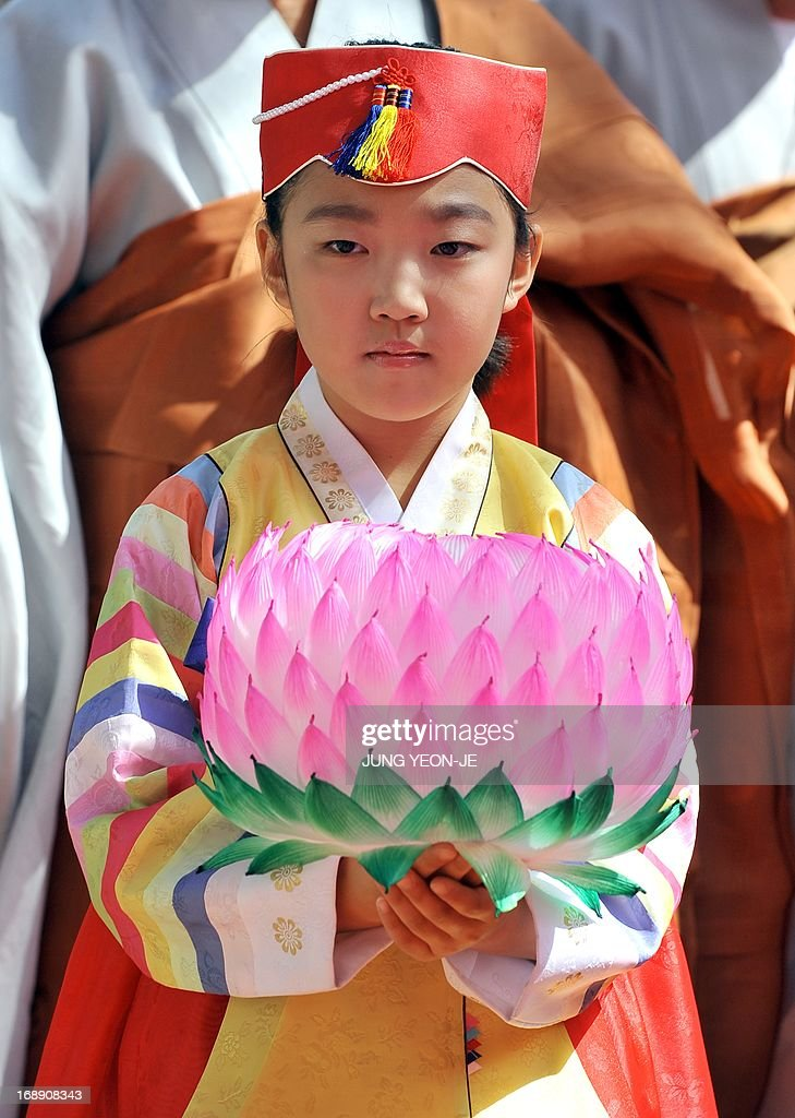 A South Korean girl wearing a traditional dress carries a lotus lantern during a ceremony to celebrate the birthday of Buddha at Jogye temple in Seoul on May 17, 2013. Buddhism is one of South Korea's largest and most active religions with millions of followers. Although the exact date is unknown, Buddha's official birthday is celebrated on April 8th of the lunar calendar in South Korea.
