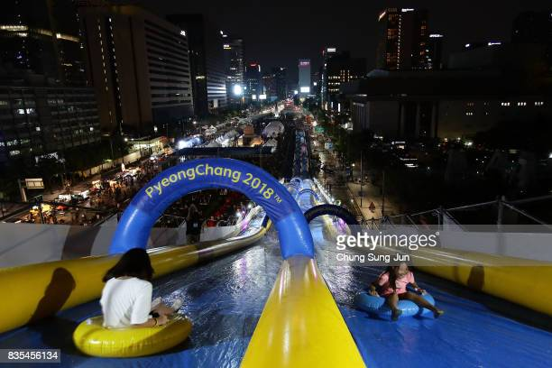 South Korean girls slide down on an inflatable ring during the 'Bobsleigh In the City' on August 19 2017 in Seoul South Korea The 22metrehigh...