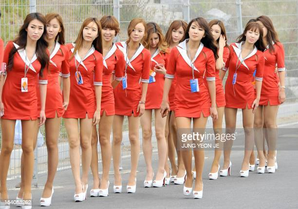 South Korean grid girls wait to enter the paddock of the Korean circuit for the Formula One Korean Grand Prix in Yeongam on October 14 2012 AFP PHOTO...