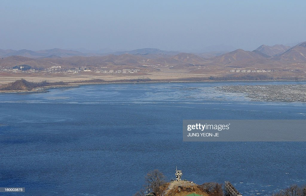 A South Korean guard post (bottom) overlooks North Korea's border county of Kaepoong, as seen from a South Korean observation post in Paju near the Demilitarized Zone (DMZ) dividing the two Koreas on January 25, 2013. North Korea on January 25 threatened 'physical counter-measures' against rival South Korea, the latest in a series of bellicose warnings sparked by a tightening of UN sanctions against Pyongyang.