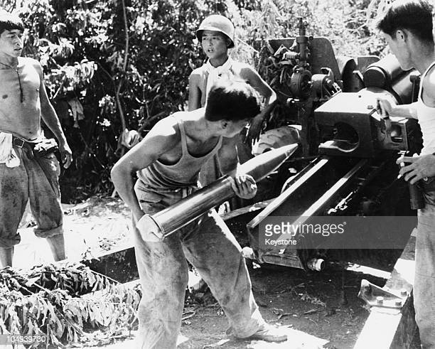 A South Korean gun crew preparing to fire a 105 mm Howitzer in support of the 1st Korean Infantry Division during the Korean War 12th August 1950