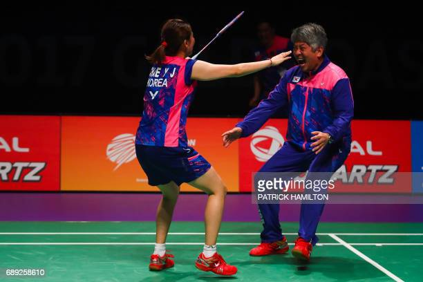 South Korean head coach Kang KyungJin celebrates with player Chae YooJung following their victory over China in the team final at the 2017 Sudirman...
