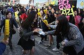 South Korean high school girls cheer for their senior classmates taking the College Scholastic Ability Test on November 12 2014 in Seoul South Korea...