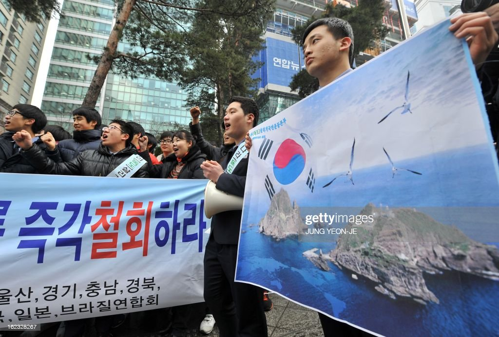 South Korean high school students attend an anti-Japan rally outside the Japanese embassy in Seoul on February 22, 2013 denouncing Japan's claims to the tiny chain of Seoul-controlled rocky islands, known as Dokdo in Korea and Takeshima in Japan. South Korea bashed Japan on February 22 for holding an annual rally to renew its claim to a set of tiny islands controlled by South Korea, which has been at the centre of a long-standing territorial feud.