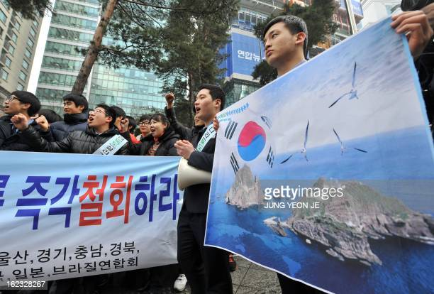 South Korean high school students attend an antiJapan rally outside the Japanese embassy in Seoul on February 22 2013 denouncing Japan's claims to...