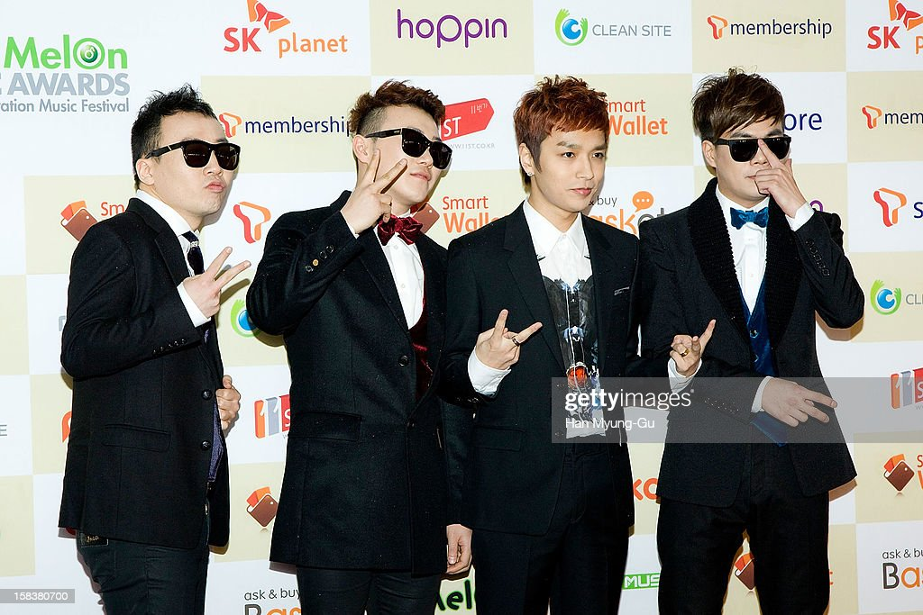 South Korean hip hop singer Simon D (2nd R) arrives at the 2012 Melon Music Awards at Olympic Gymnasium on December 14, 2012 in Seoul, South Korea.