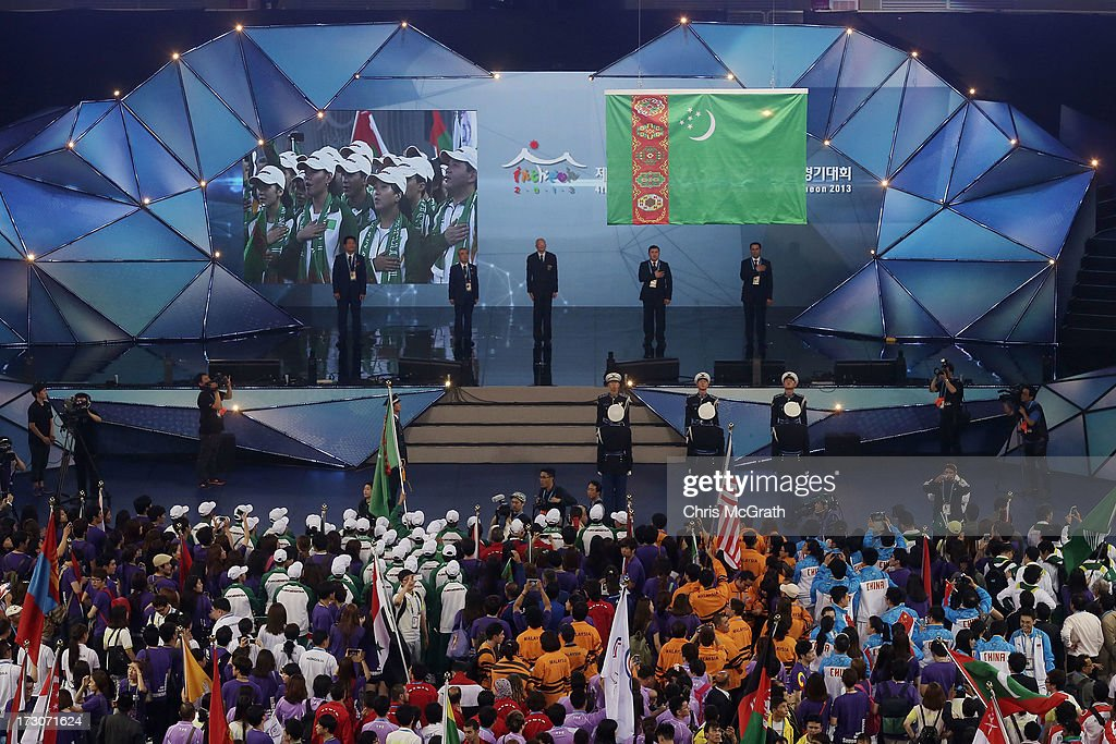 A South Korean honor guard raise the Turkmenistan flag, the next host city of the Asian Indoor & Martial Arts Games during the closing ceremony of the 4th Asian Indoor & Martial Arts Games at Incheon Samsan World Gymansium on July 6, 2013 in Incheon, South Korea.