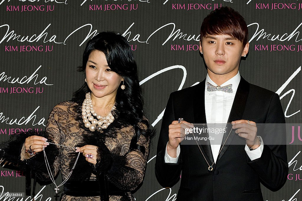 South Korean Jewelry designer Kim Jeong-Ju and leading singer Kim Jun-Su of <a gi-track='captionPersonalityLinkClicked' href=/galleries/search?phrase=JYJ&family=editorial&specificpeople=3039772 ng-click='$event.stopPropagation()'>JYJ</a> poses for media during at 2011 The Asia Jewelry Awards on December 6, 2011 in Seoul, South Korea.