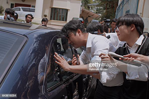 South Korean journalists scramble to get information from unidentified man as he exits the North Korean Embassy compound on February 22 2017 in Kuala...