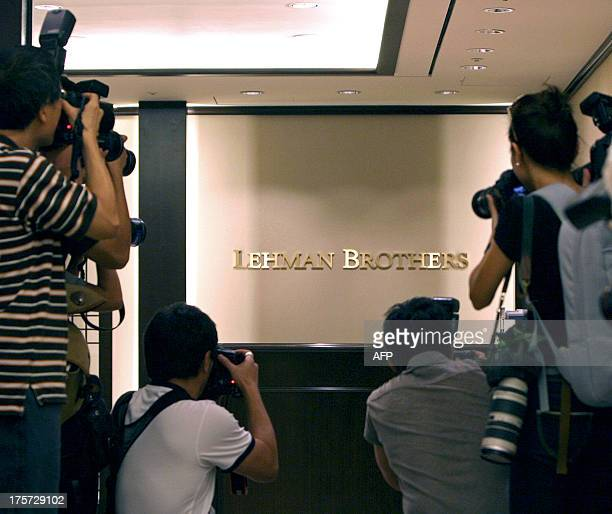 South Korean journalists take pictures of the branch of bankrupt US investment bank Lehman Brothers in Seoul on September 16 2008 South Korean...