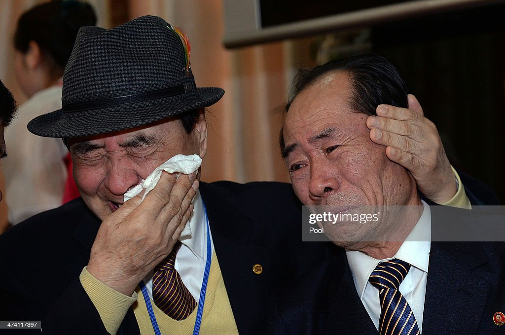 South Korean Jung Hee-Kyung (L), 81, bids farewell to his North Korean relative before they return to their home after a family reunion having been separated for 60 years following the Korean War on February 22, 2014 in Mount Kumgang, North Korea. The program, which allows reunions of family members separated by the 1950-53 Korean war, is a result of recent agreement between North and South Korea which had been suspended since 2010.