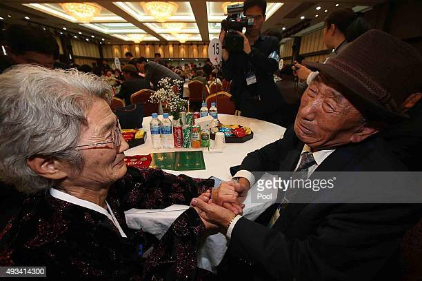 South Korean Kim BockRack meets with his North Korean sister Kim JeonSoon during the family reunion after being separated for 60 years on October 20...
