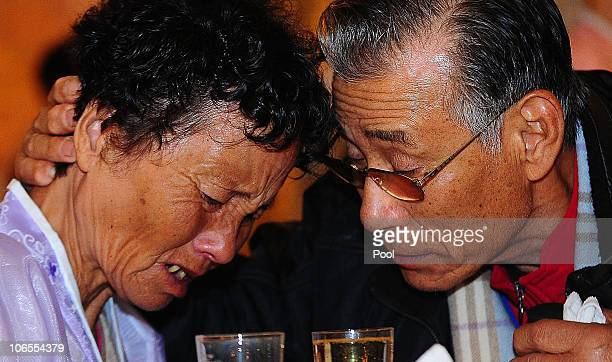 South Korean Kim JungMan bid farewell to his North Korean relative before they return to their home after a family reunion having been separated for...