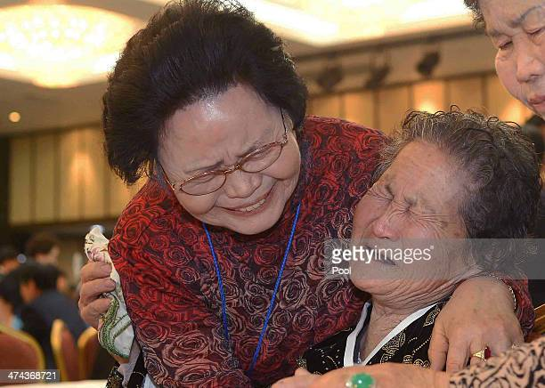 South Korean Kim SaMoon meets with her North Korean older sister Kim TaeUn during a family reunion after being separated for 60 years on February 23...