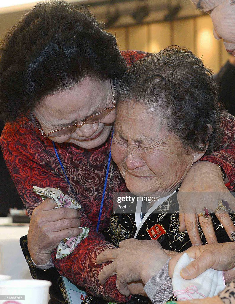 South Korean Kim Sa-Moon (L) meets with her North Korean older sister Kim Tae-Un (R),78, during a family reunion after being separated for 60 years on February 23, 2014 in Mount Kumgang, North Korea. The program, which allows reunions of family members separated by the 1950-53 Korean war, is a result of recent agreement between Koreas which had been suspended since 2010.