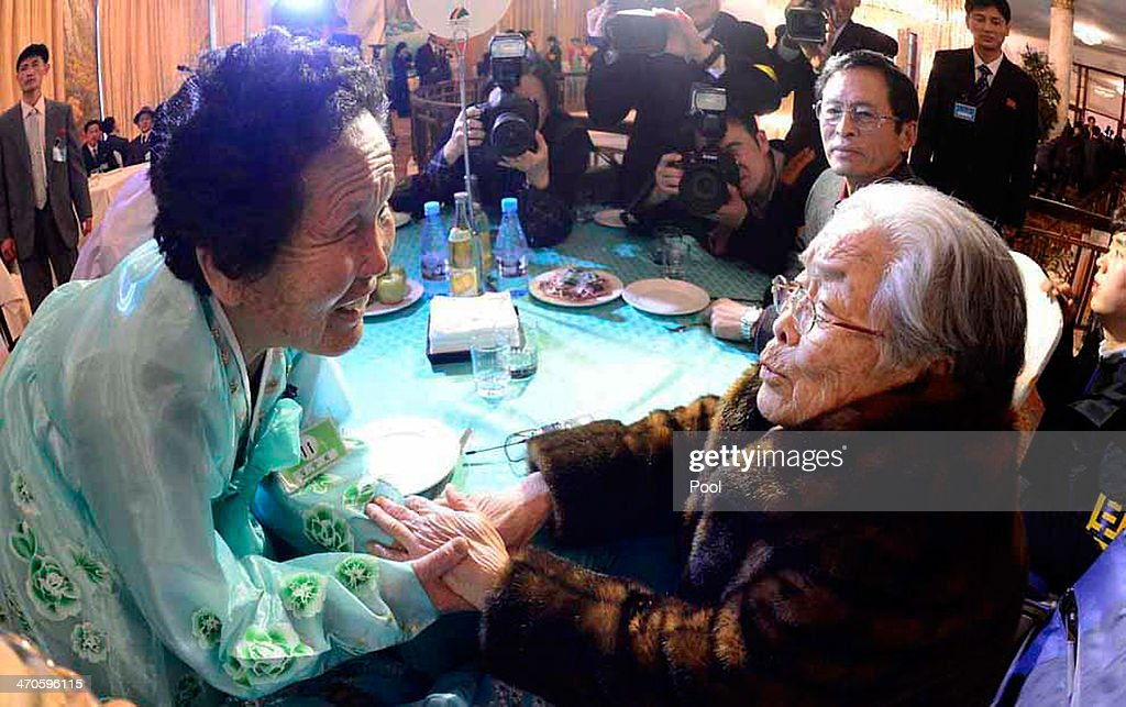South Korean Kim Sung-Yoon (R), 96, meets with her North Korean sister during a family reunion after being separated for 60 years on February 20, 2014 in Mount Kumgang, North Korea. The program, which allows reunions of family members separated by the 1950-53 Korean war, is a result of recent agreement between Koreas which had been suspended since 2010.