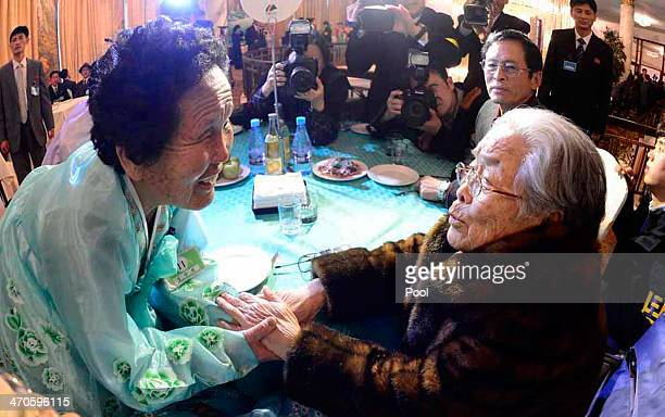 South Korean Kim SungYoon meets with her North Korean sister during a family reunion after being separated for 60 years on February 20 2014 in Mount...