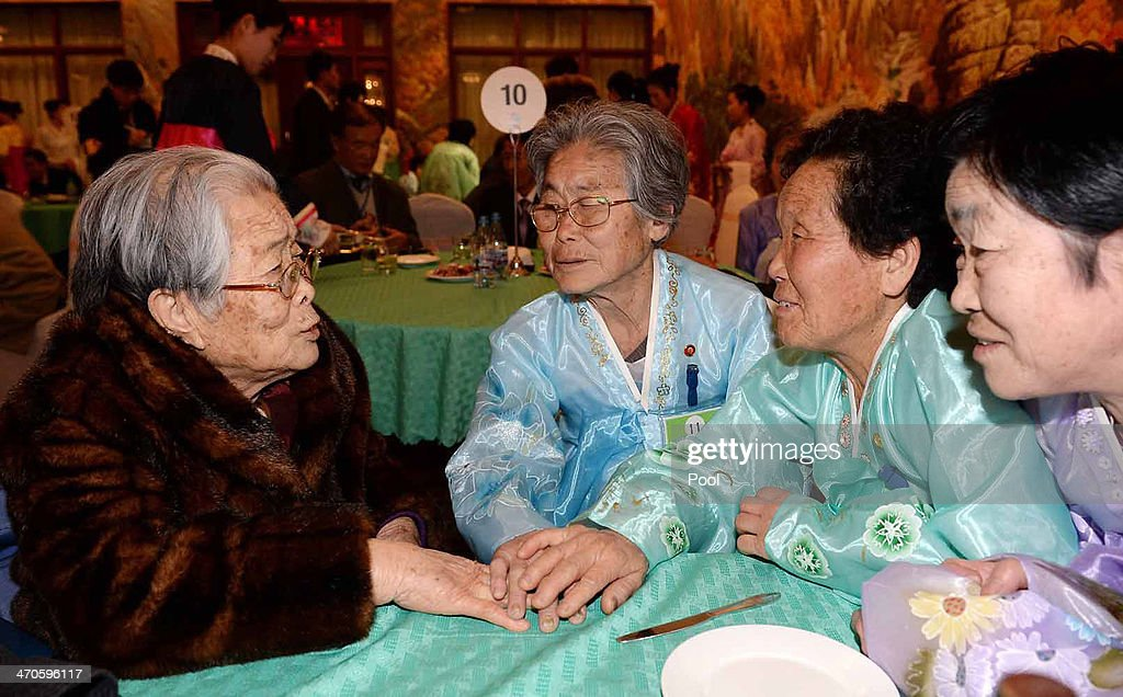 South Korean Kim Sung-Yoon (L), 96, meets with her North Korean sisters during a family reunion after being separated for 60 years on February 20, 2014 in Mount Kumgang, North Korea. The program, which allows reunions of family members separated by the 1950-53 Korean war, is a result of recent agreement between Koreas which had been suspended since 2010.