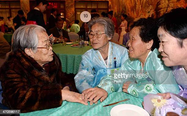 South Korean Kim SungYoon meets with her North Korean sisters during a family reunion after being separated for 60 years on February 20 2014 in Mount...