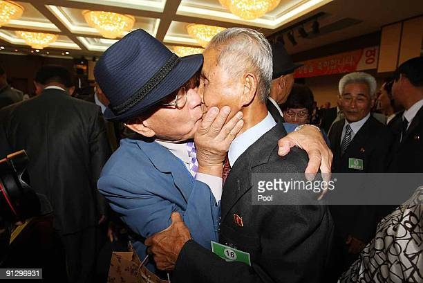 South Korean Kwon GiSeok bids farewell to his North Korean relative Kwon SiJoong after the separated family reunion meeting at the Mount Kumgang...