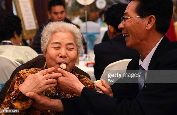 South Korean Lee ChangJu and her North Korean relative attend a family reunion after being separated for 60 years on February 21 2014 in Mount...