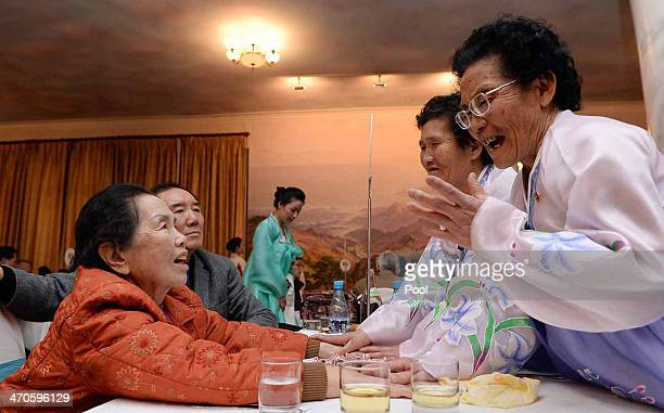 South Korean Lee OhHwan meets with her North Korean sisters during a family reunion after being separated for 60 years on February 20 2014 in Mount...