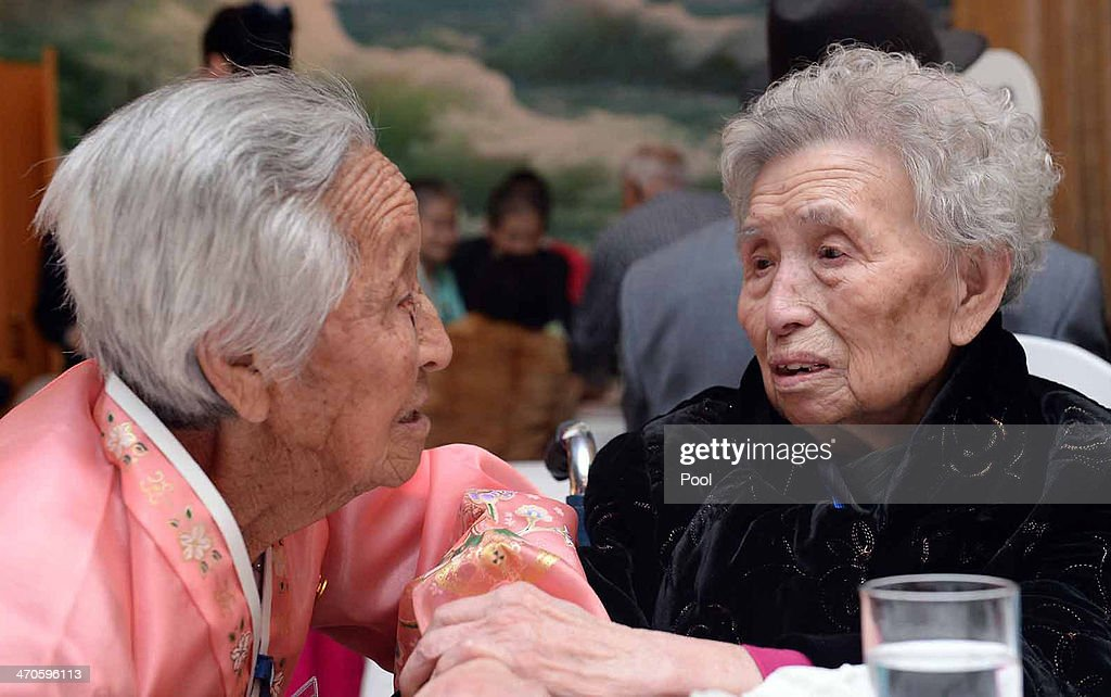 South Korean Lee Young-Shil (R),88, meets with her North Korean sister Lee Jung-Shil during a family reunion after being separated for 60 years on February 20, 2014 in Mount Kumgang, North Korea. The program, which allows reunions of family members separated by the 1950-53 Korean war, is a result of recent agreement between Koreas which had been suspended since 2010.