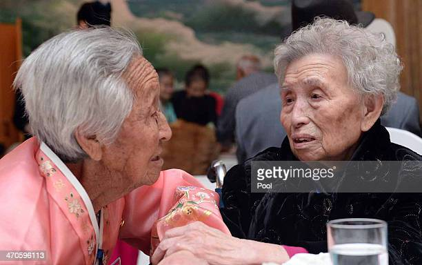 South Korean Lee YoungShil meets with her North Korean sister Lee JungShil during a family reunion after being separated for 60 years on February 20...