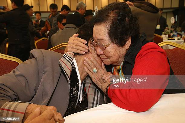 South Korean Lim OkNam hugs with her North Korean sister Rim OkRye during the family reunion after being separated for 60 years on October 21 2015 in...
