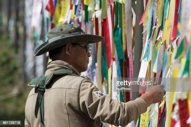 A South Korean man arranges colorful ribbons in Imjingak Park near the Demilitarized Zone on October 14 2017 in the city of Paju South Korea North...